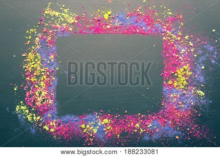Colorful Indian Holi dyes frame. Holi festival dyes background with copyspace. Flat lay. Top view