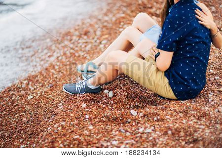 Women's and men's feet in the sand. Wedding in Montenegro