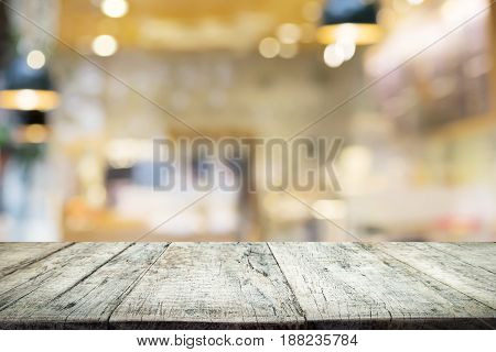 Empty Wooden Table For Present Product On Coffee Shop Or Soft Drink Bar Blur Background With Bokeh I