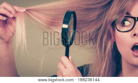 Woman Holding Magnifying Glass Looking At Hair