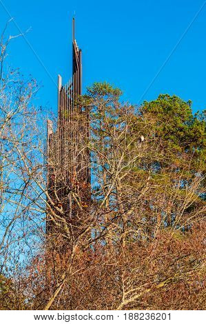 Carillon closeup seen behind the bare trees in Stone Mountain Park In sunny autumn day Georgia USA