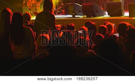 Abstract blurred - people listen to a rock concert in club