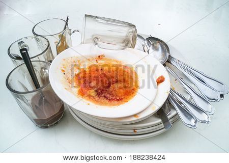 Pile Of Dirty Oily Plates, Glass, Fork Spoons After Meal