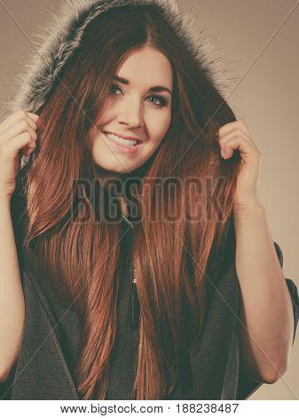 Happy Woman Wearing Dark Poncho With Hood