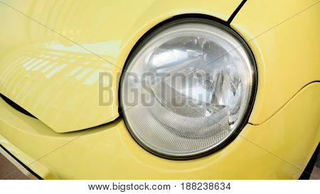 Lamp is dim not clear a font of small car yellow color.