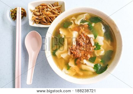 Flat flour noodle soup or Pan Mee popular traditional Malaysia Chinese cuisine