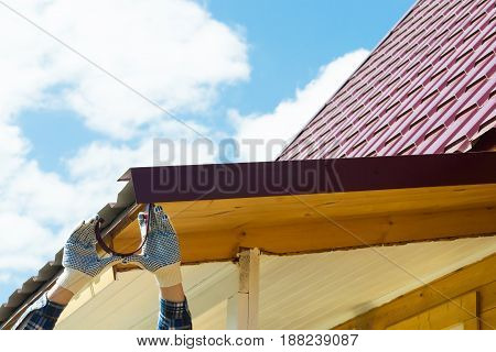 Roof repair by a master against a blue sky background