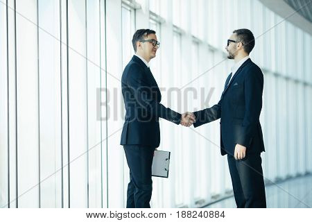 Manager And Boss Handshake In Big Hall Room