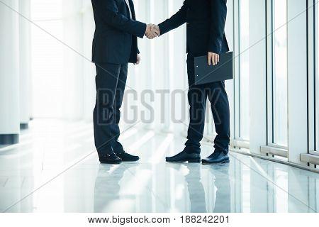 Close Up Of Men Handshake In Office Room