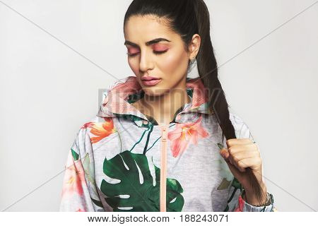 Pretty Woman With Eyes Closed Holding Hair
