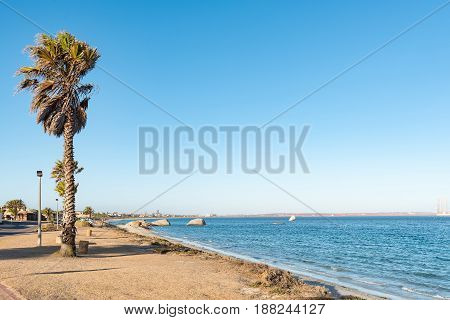 A beach in the late afternoon sun in Saldanha Bay a town in the Western Cape Province