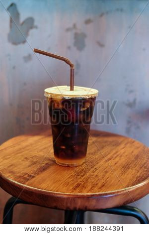Iced Americano black coffee on a wooden table