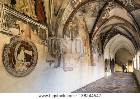 Brixen Italy - December 26 2016: Cathedral cloister with the frescoed wall. The ceiling cloister with depicting scenes of the Bible.