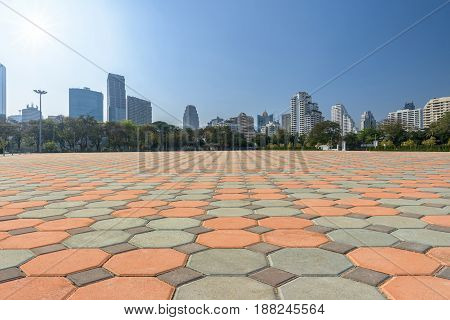 empty brick floor and city with blue sky