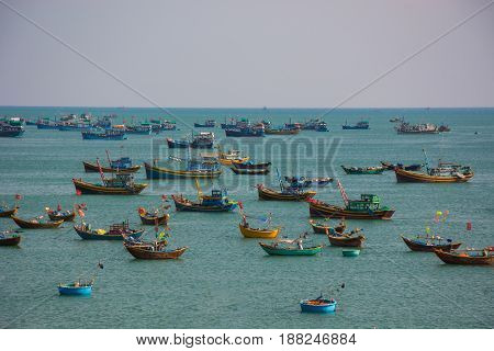 Vietnamese fishing village with traditional colorful fishing boats at Mui Ne Vietnam Southeast Asia.