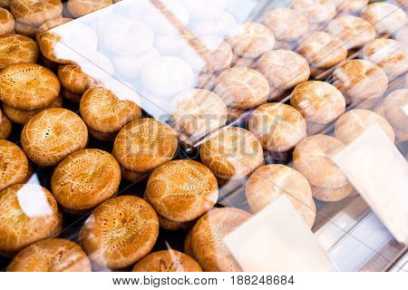 home made scones display on a square. under glass showcase