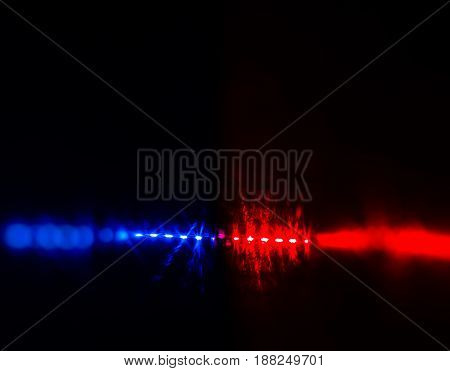 Flashing Red And Blue Police Car Lights In Night Time.