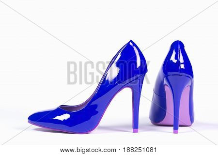Sexy blue shoes high heels are on white background.