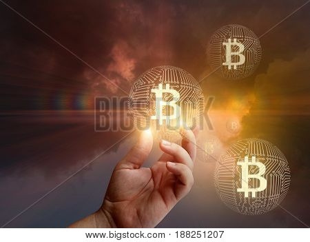 Hand Of A Businessman Shows The Bitcoin.