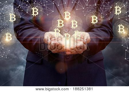 Businessman Supports Bitcoins In His Hands.