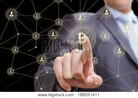 Businessman Clicks On The Button Of Bitcoin.