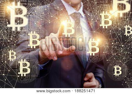 Businessman Clicks On Of Bitcoin.