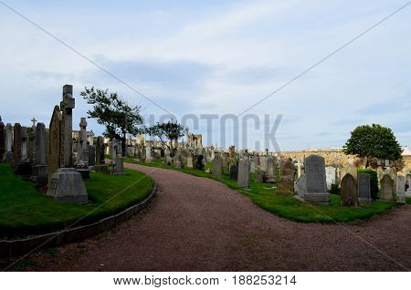 Stone monuments in the cemetery at St Andrew's.
