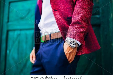 Closeup fashion image of luxury watch on wrist of man.body detail of a business man.Fashion portrait of young businessman handsome model man in casual cloth suit with accessories on hands.