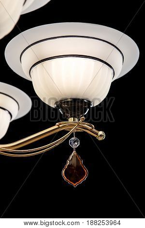 Classic Chandelier for interior decoration of the living room. Chandelier close-up photo isolated on black background. Gold modern a piece of interior for designers.