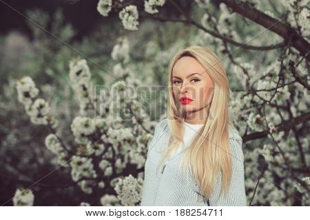 garden with spring flowers and woman on natural background health and nature fashion design mothers day valentines day and wedding