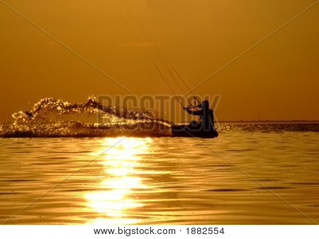Silhouette Of A Kitesurf On A Gulf On A Sunset