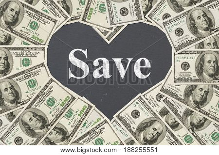 The love of saving money message One hundred dollar bill in the shape of a heart with a chalkboard heart with text Save
