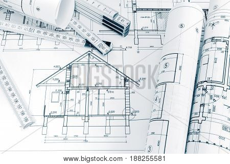 Engineering Plans Of House Renovation And Folding Ruler On Architects Workspace