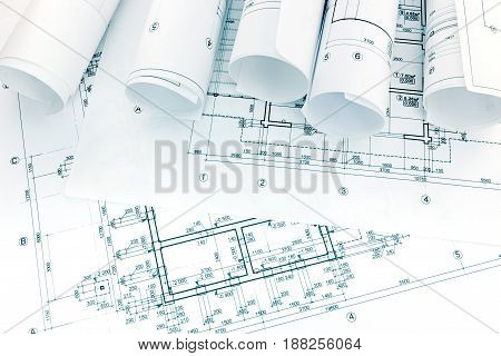 Architectural And Engineering Drawings With Rolls Of Blueprints