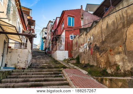 Colorful Living Houses Along Stone Stairway
