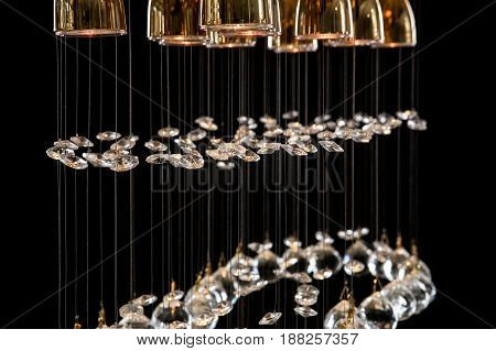 Modern Chandelier for interior of the living room. a bunch of crystal balls isolated on black background. Many light bulbs