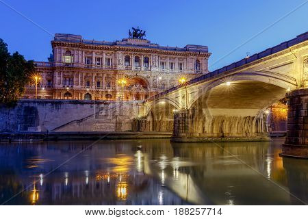 Night view of the Palace of Justice and the Umberto Bridge across the Tiber River. Rome. Italy.