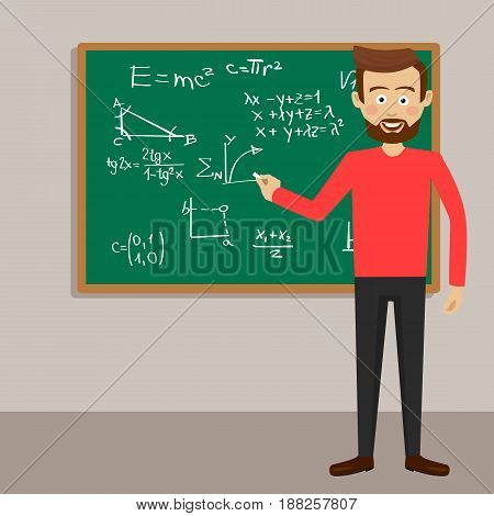 Male young teacher in classroom next to blackboard with physical equations and formulas