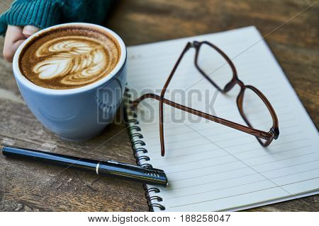 Morning Coffee Time with Brown Wooden Background