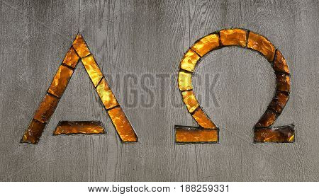 Alpha and Omega Signs in glass close up.