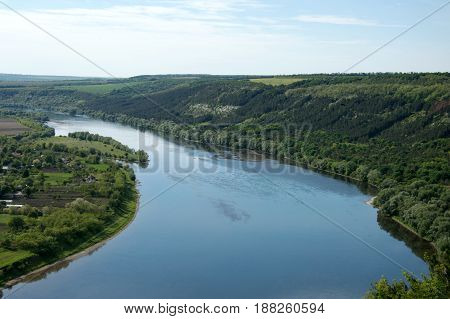 storks fly over the river a panorama of the mouth of the river a flight of storks great views of the river the panorama of the river Dnister Ukrainian river