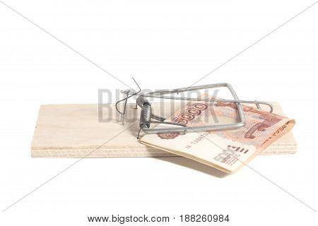 Mousetrap with Russian five thousand ruble banknotes isolated on white background