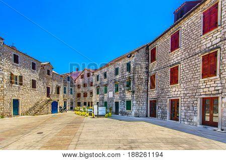 Colorful ancient square in Starigrad place, summer travel destination in Croatia, Iland Hvar scenery.