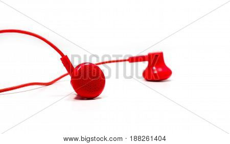 Red earphone on white background.Red earphone on white background.