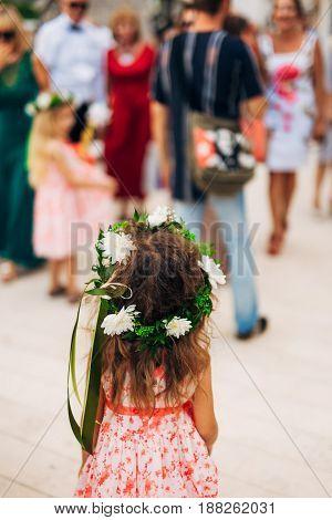 Little girl wearing a crown of flowers in Montenegro