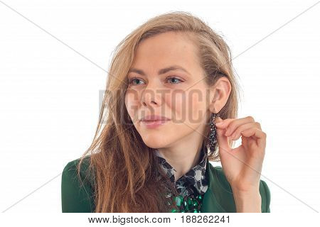 Portrait of a beautiful young blonde who took a glance to the side and smiling close-up isolated on white background