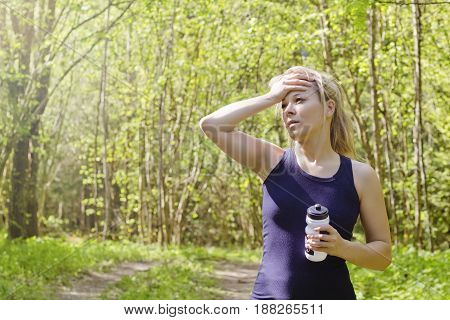 Beautiful young woman exhausted from workout running jogging fitness outdoor tied thirsty feeling sport woman fitness outdoor concept.