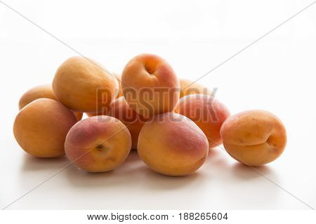 Organic healthy apricots fruit on a white background