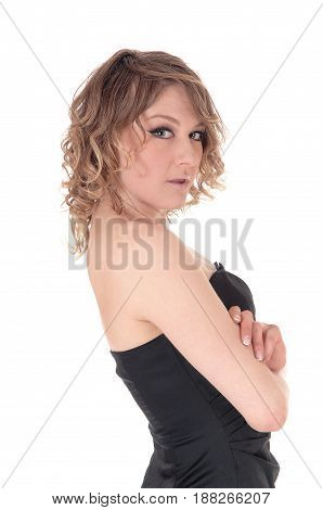 A closeup portrait image of a young blond woman with her hands crossed in a black dress isolated for white background.