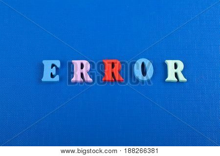 ERROR word on blue background composed from colorful abc alphabet block wooden letters, copy space for ad text. Learning english concept
